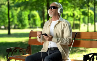 old blind man with headphones