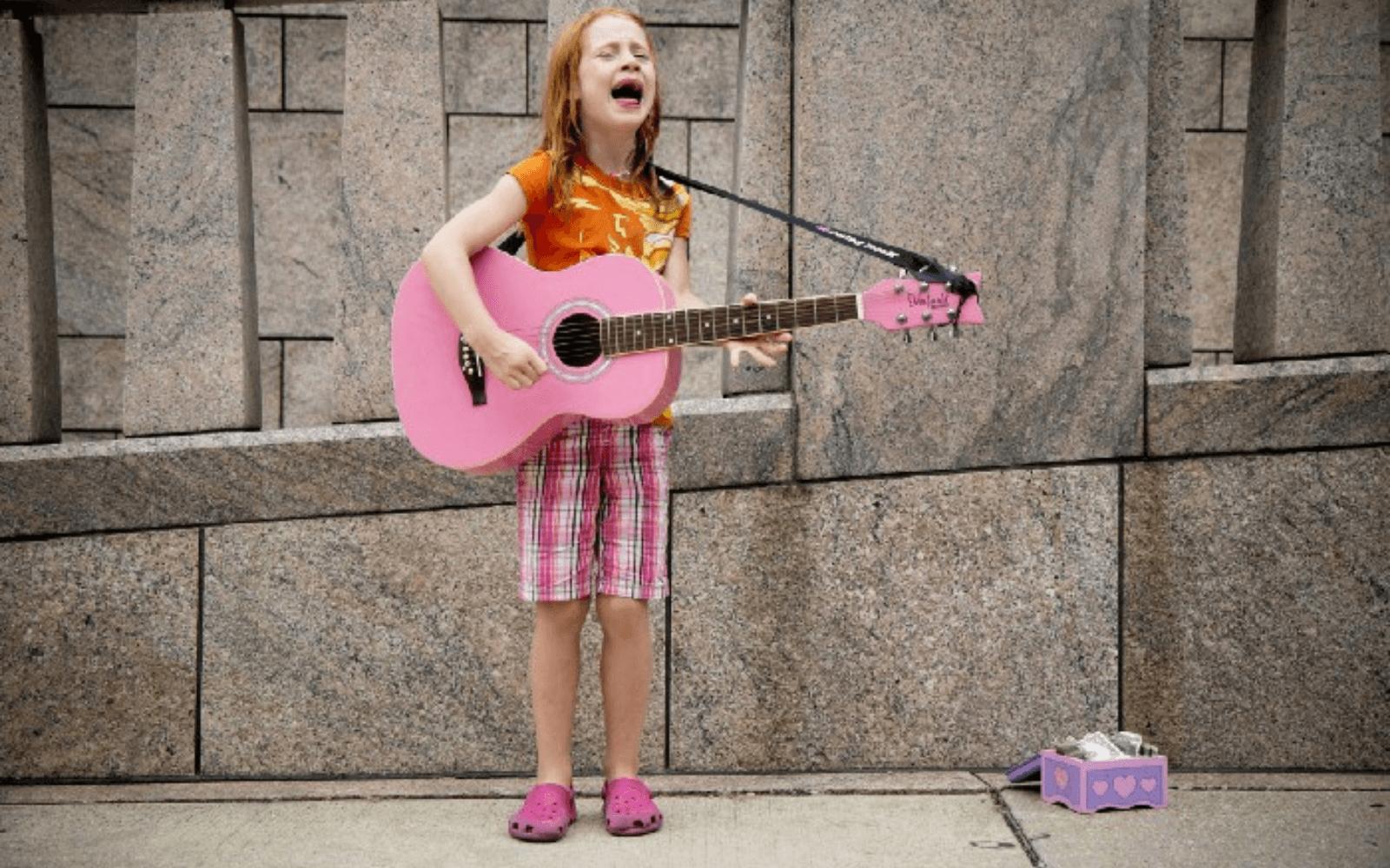 girl crying playing guitar